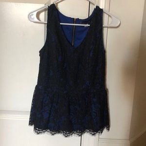 Blue underlay, black lace peplum top